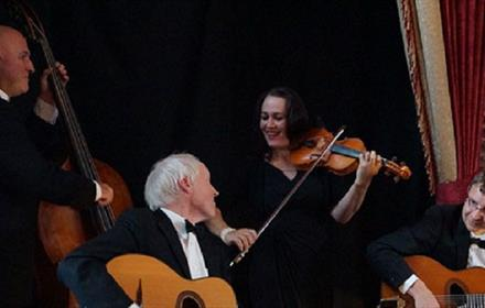 Three men, playing guitar, double base, and woman playing violin