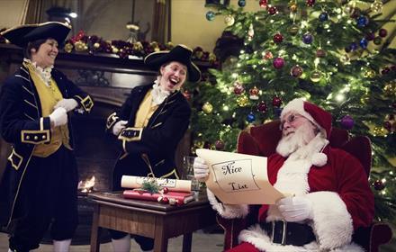 Santa, Christmas Tree, two people in costume