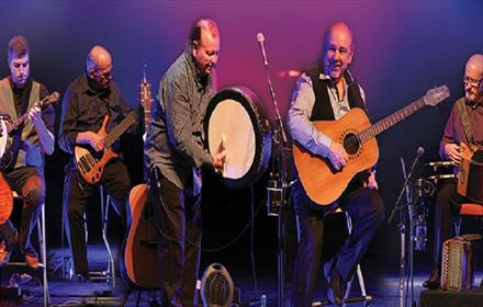 Image of The Fureys on stage.