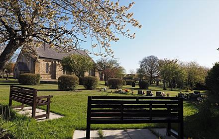 External view of Holy Trinity Church, Wingate Image of the grounds surrounding the church
