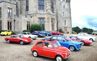 A range of Italian cars parked in front of Raby Castle