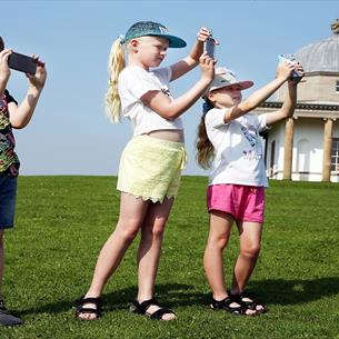Three children at Hardwick Park using App