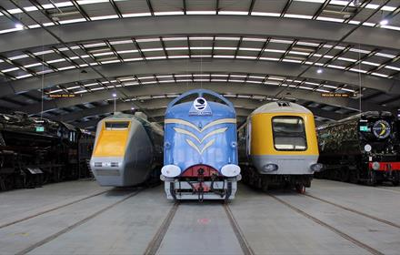 Locomotives at Locomotion, one blue, two yellow and grey  Image copyright - The Board of Trustees of the Science Museum Group