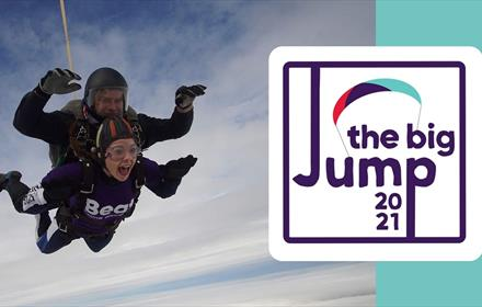 The Big Jump: image of two people skydiving mid jump