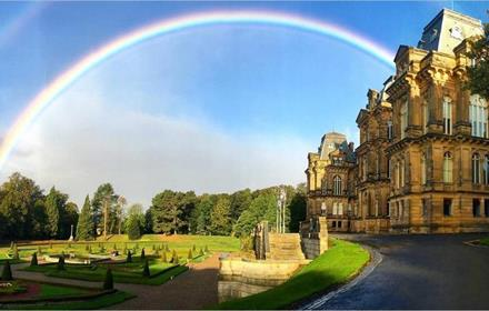 The Bowes Museum on a sunny day with rainbow arching over the grounds