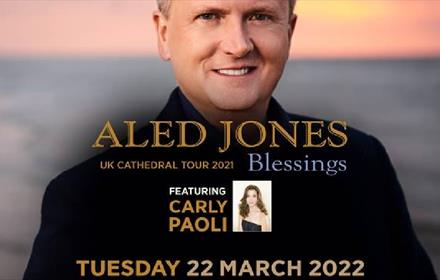 Image of Aled Jones in front of a seascape background