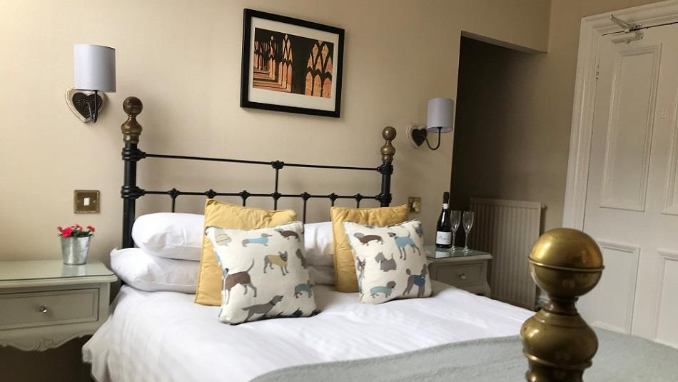 Double bed, cushions, picture, wall lights