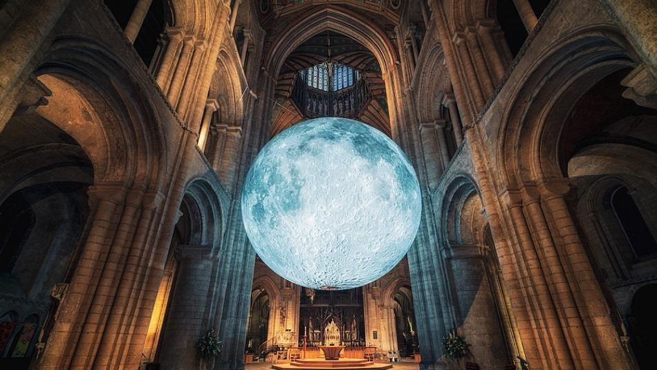 A large moon art installation inside Ely Cathedral. Image credit: James Billings