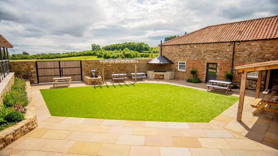 Cafe courtyard, paving, grassed area, bbq
