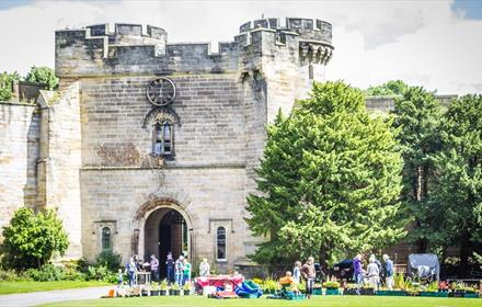 Brancepeth Castle courtyard, people looking at stalls, sunny day
