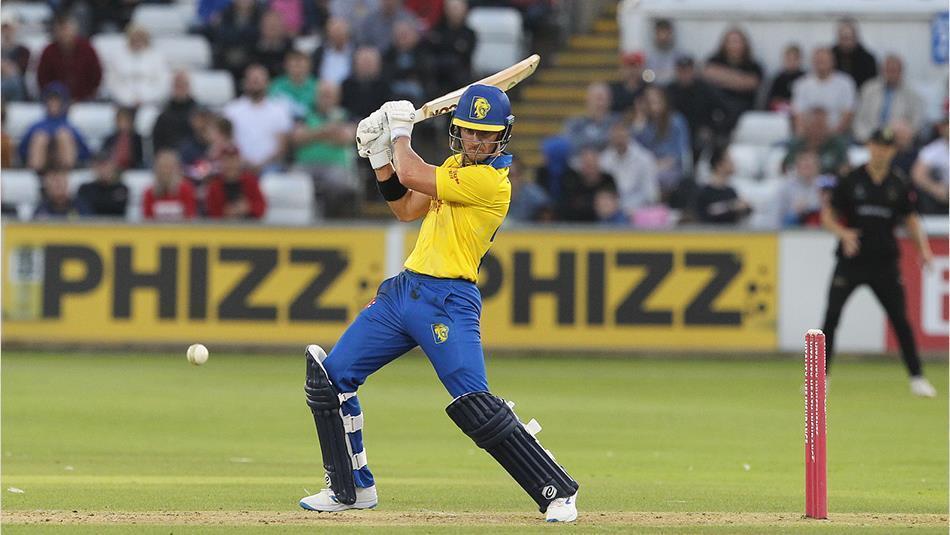 man playing cricket.  Batsman