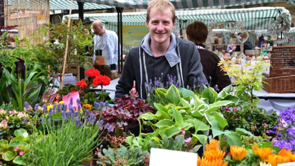 Man with flowers at Durham City Farmers' Market