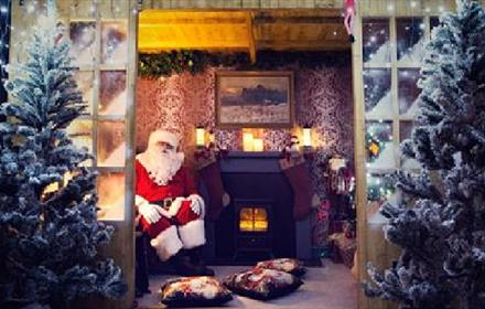 Santa inside his winter wonderland grotto at The Bowes Museum
