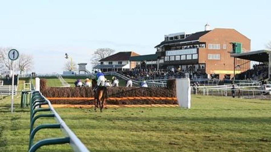 Sedgefield Racecourse Pavillion: horses jumping over hurdles