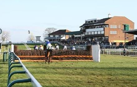 Sedgefield Racecourse Pavillion: horses jumping over hurdles
