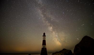 Beachy Head Lighthouse at night with starry sky