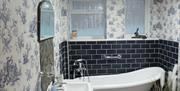 En-suite bathroom with slipper bath