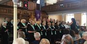 A choir stood front and centre stage in the toll gavel united church, in East Yorkshire