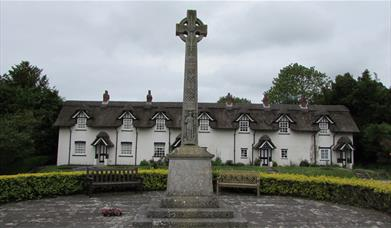 Warter village, East Yorkshire with  Memorial Cross and thatched cottages