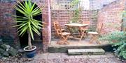 The Garden with private patio and lights at Milliner's Cottage, Pocklington, East Yorkshire.