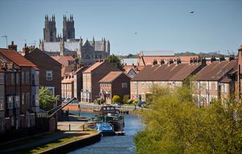 Looking between houses towards the Minster and Beverley Beck in East Yorkshire.