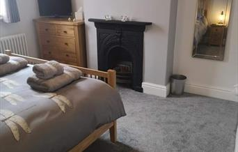 The double room with feature fireplace at Dragonfly Cottage in East Yorkshire.