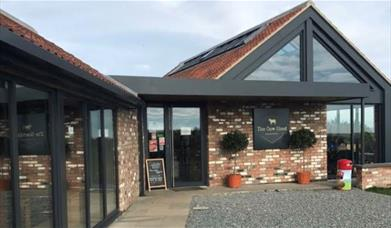 The front entrance and bifold windows at the Cow Shed, in East Yorkshire