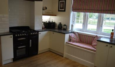 The kitchen with snug seating fitted underneath the kitchen window at Stacey Cottage in East Yorkshire.