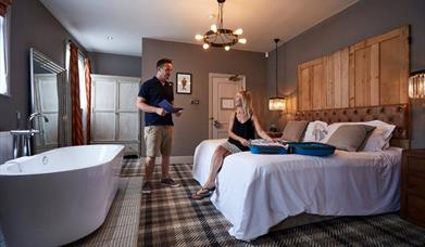A double bedroom with feature bath at The Kings Head in East Yorkshire.