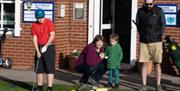 Families enjoying learning to play at the golf course at Beverley & East Riding Golf Club, in Beverley, East Yorkshire