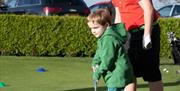 Having fun at the golf course at Beverley & East Riding Golf Club, in Beverley, East Yorkshire