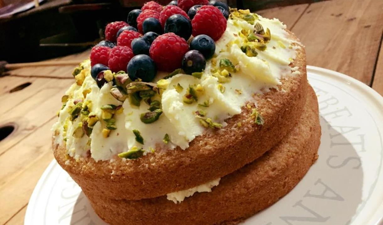 A sponge cake topped with butter icing and raspberries and blueberries, East Yorkshire