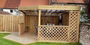 The garden area, with pergola, at Travellers Rest Apartment, Beverley, East Yorkshire