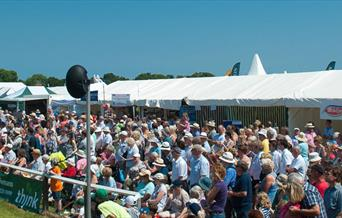 Driffield Showground with people and marquees, in East Yorkshire