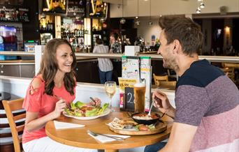 A couple eating in the restaurant at Withernsea Sands in East Yorkshire.