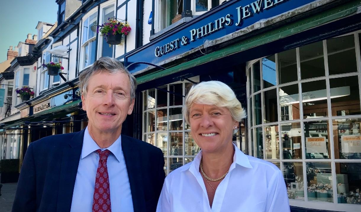 A couple stood outside the shop front of Guest & Philips Jewellers, Beverley in East Yorkshire.