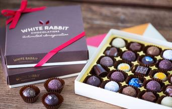 An open box of handmade chocolates from the White Rabbit chocolatiers, Beverley, East Yorkshire