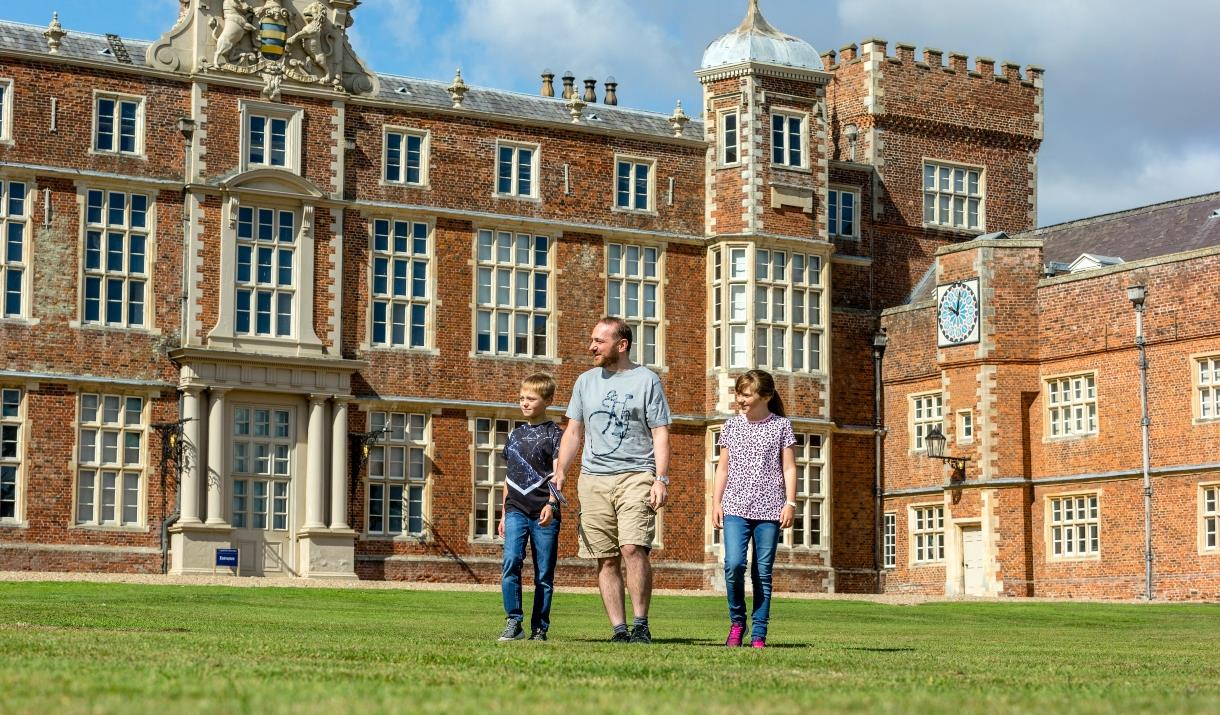 A man and two children wandering away from Burton Constable Hall, Skirlaugh in East Yorkshire.
