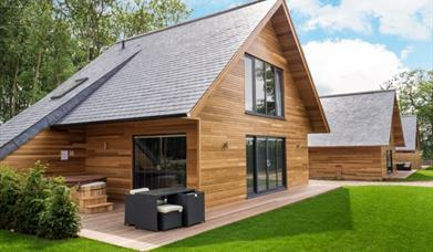 A Two story luxury wooden lodges with private outside spaces at The KP in East Yorkshire.