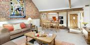 An image of the living area and kitchen in The Old Dairy at Field House Farm Cottages in East Yorkshire.