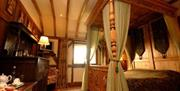 A four poster bed at The Wolds Village Luxury Guest Accommodation in East Yorkshire.