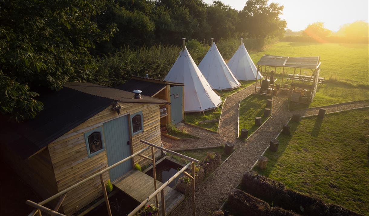 Tipis and hut at Wild Harvest School, Cottingwith, East Yorkshire.