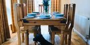 The dining area With Bertie waiting for his tea at West End Farm Cottages, Driffield, East Yorkshire.