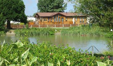 A lodge over looking the lake at Patrington Haven Leisure Park in East Yorkshire.