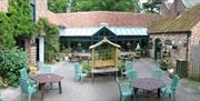 The outdoor seating area at The Wolds Village Guest Accommodation in East Yorkshire.