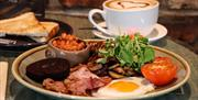 A plate of full English breakfast with toast and a cappuccino, Drewton's Eastate, East Yorkshire