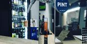 An image of the pint pulling tap and chilling fridge at Vittles & Company.