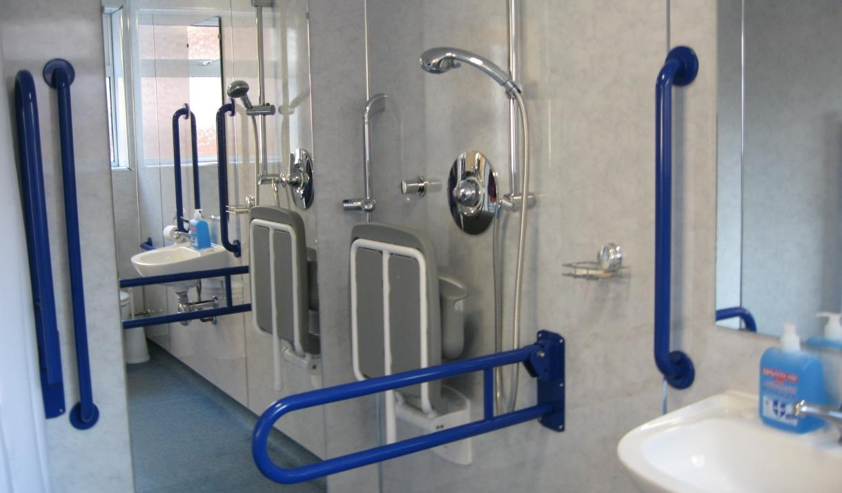 The fully adapted wet room, walk in shower with rails and assists at Pride N Joy, Bridlington in East Yorkshire.