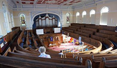 Taken from the back of the toll gavel united church looking over the church interior and organ pipes, in East Yorkshire
