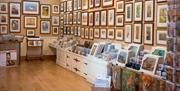 Multiple prints framed and hung around the gallery walls at the Robert Fuller Gallery, in East Yorkshire
